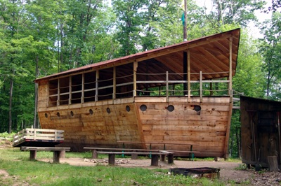 """Noah's Ark Village - - The """"Ark"""" has below deck rooms and an above deck hang out area- Contains four rooms which each house two bunk-beds- Located in a hardwood forest"""