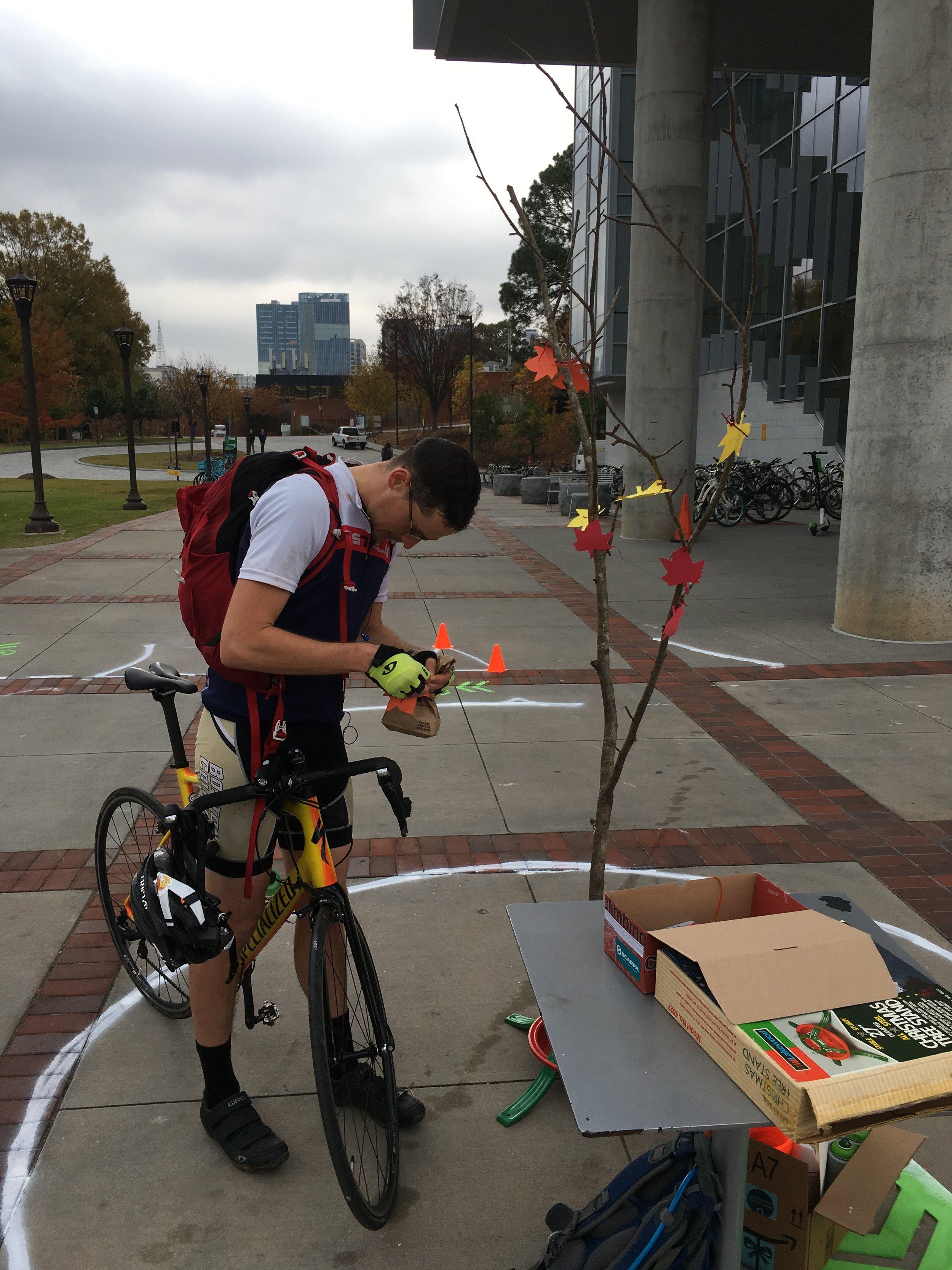 A biker who stopped to take photos of the setup and write a leaf.