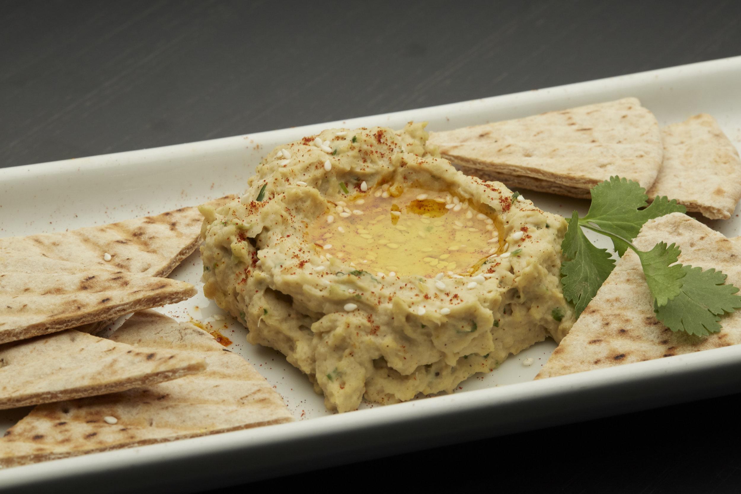 Islander Hummus - Our very own hummus served with multigrain pita wedges.