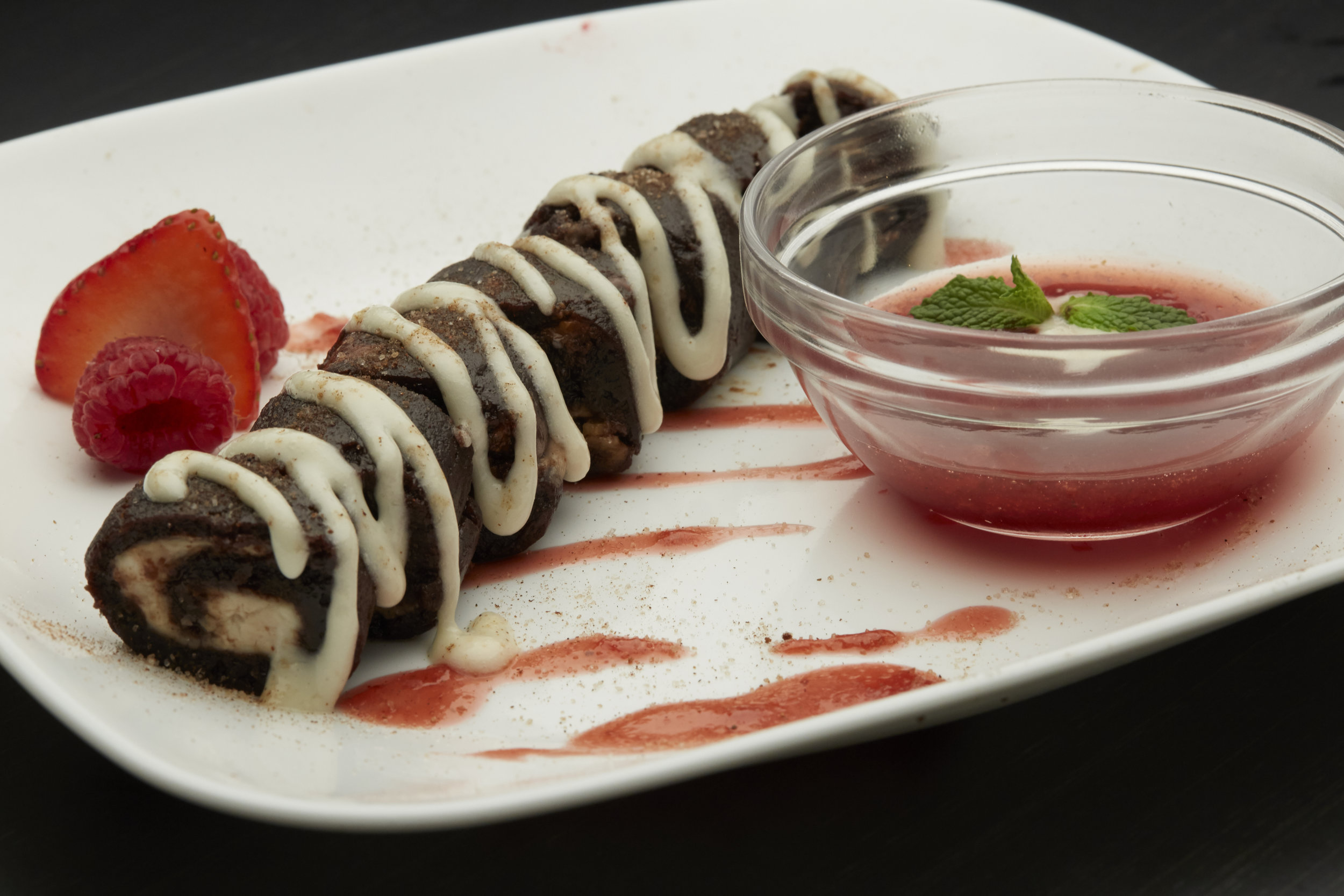 Sweet Sushi - Fudge brownie rolled with homemade strawberry and raspberry marmalade.