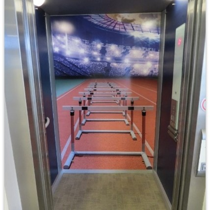 Creative large format graphics - Being creative with your workspace graphics can lead to some great effects, we've even created the illusion of the Olympic Stadium in an elevator!
