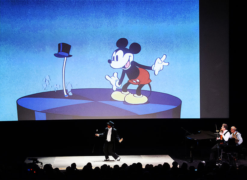 DeWitt Fleming, Jr. dancing with Mickey Mouse in 'Through the Looking Glass'
