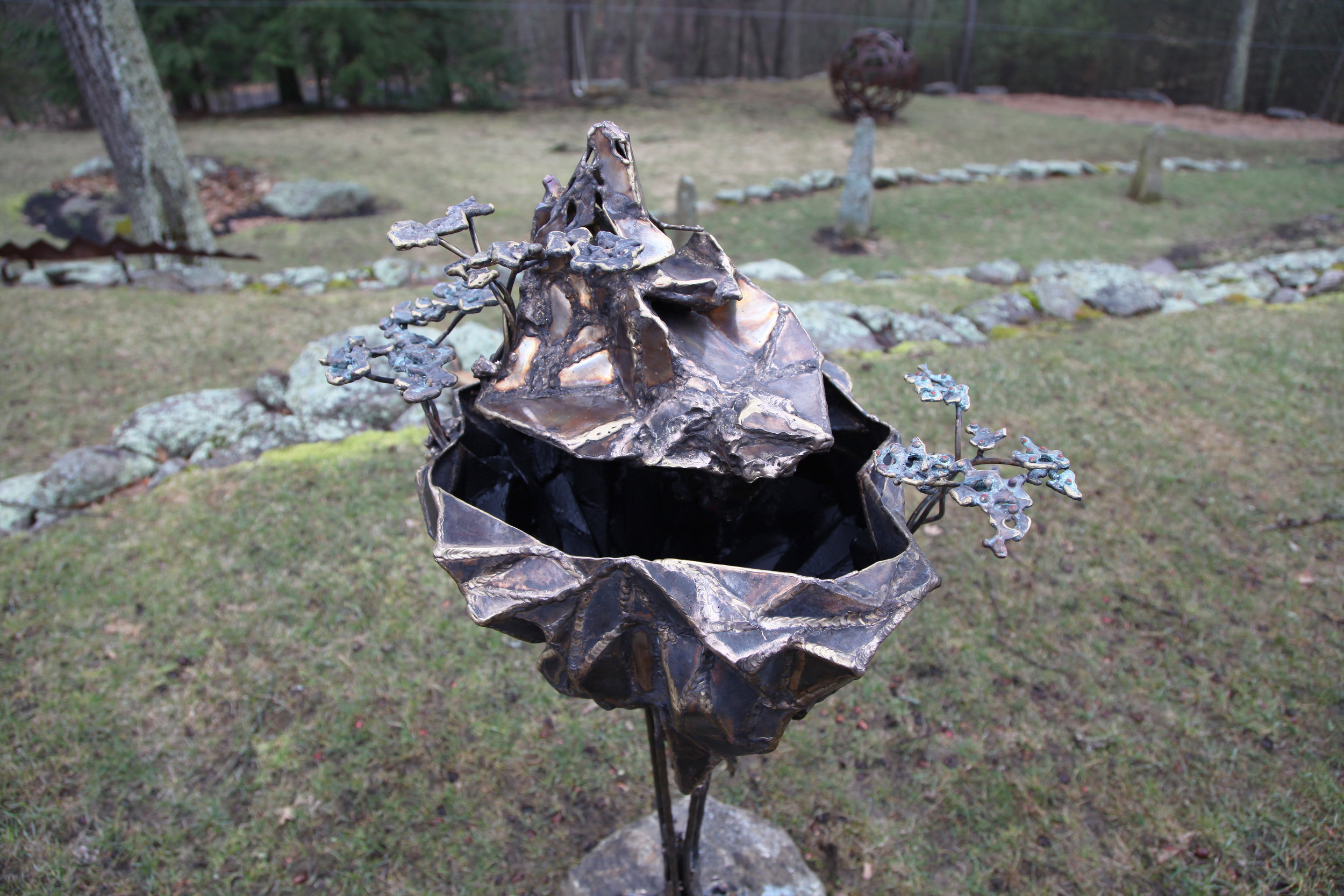 floating fountain, floating fountain sculpture, bronze water fountain, water fountain, avatar fountain