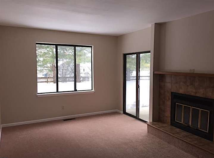 Our living room, before we moved in. With no furniture or window treatments, you can clearly see the stark modern style of the window frame. You can also see how bland the room looked before we furnished it!