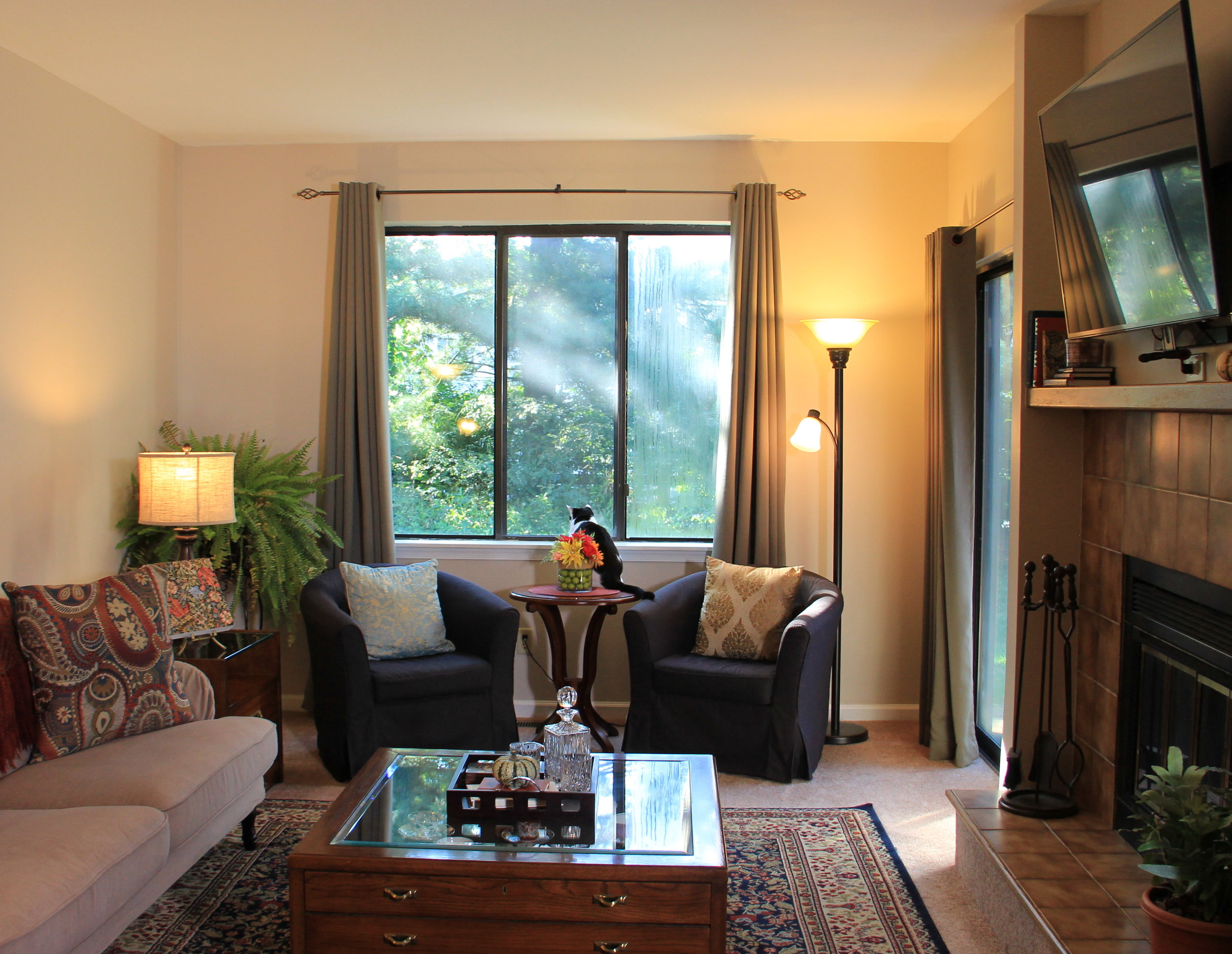 A similar view of our living room, with window treatments and furniture. Doesn't it make a HUGE difference?