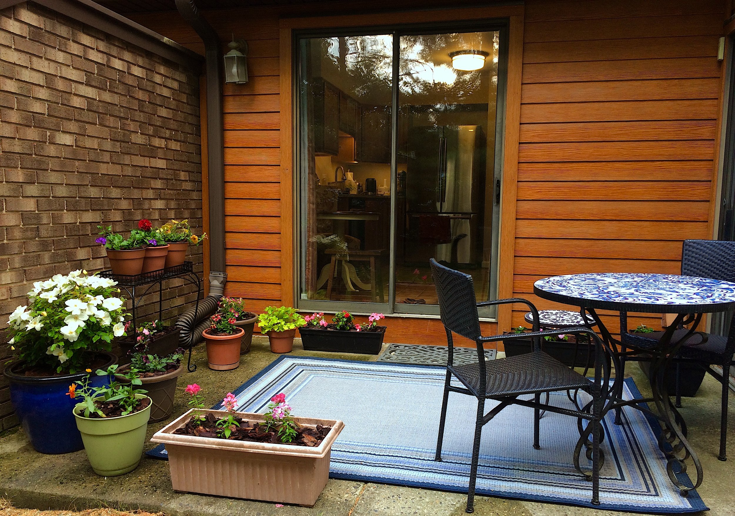 Mosaic Bistro Table from Pier1  (unfortunately, the one I have is no longer available),  Del Rey Stacking Chairs  from Pier1 in Black,  Allen + Roth Outdoor Blue Rug  from Lowes,  Mohawk Home Core Doormat  in Black from Lowes