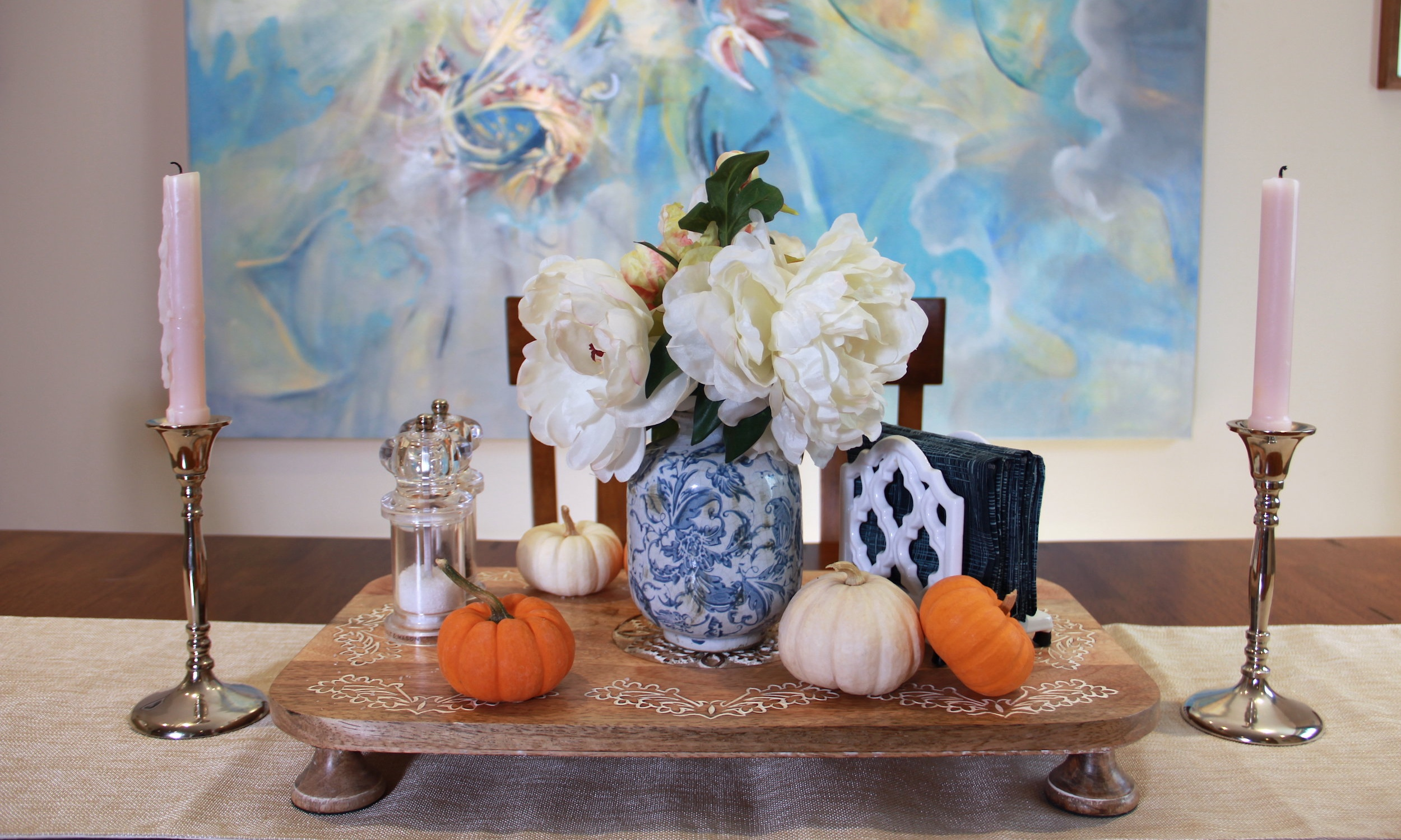 Fall Tablescape.  The addition of mini pumpkins helps to give this simple arrangement an autumnal feel.