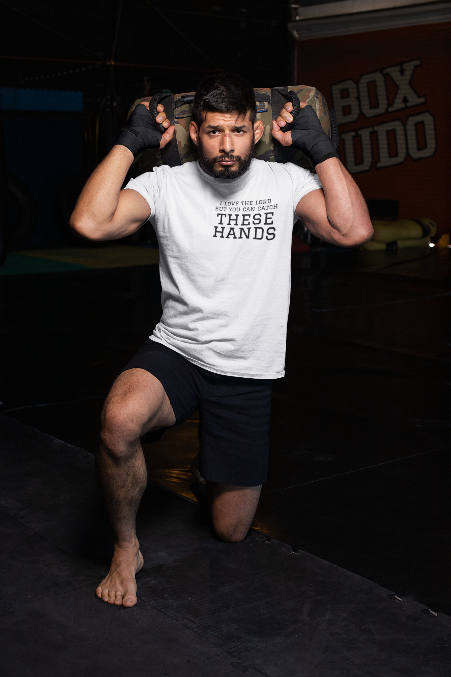 t-shirt-mockup-of-an-mma-fighter-kneeling-at-a-boxing-gym-26252.png
