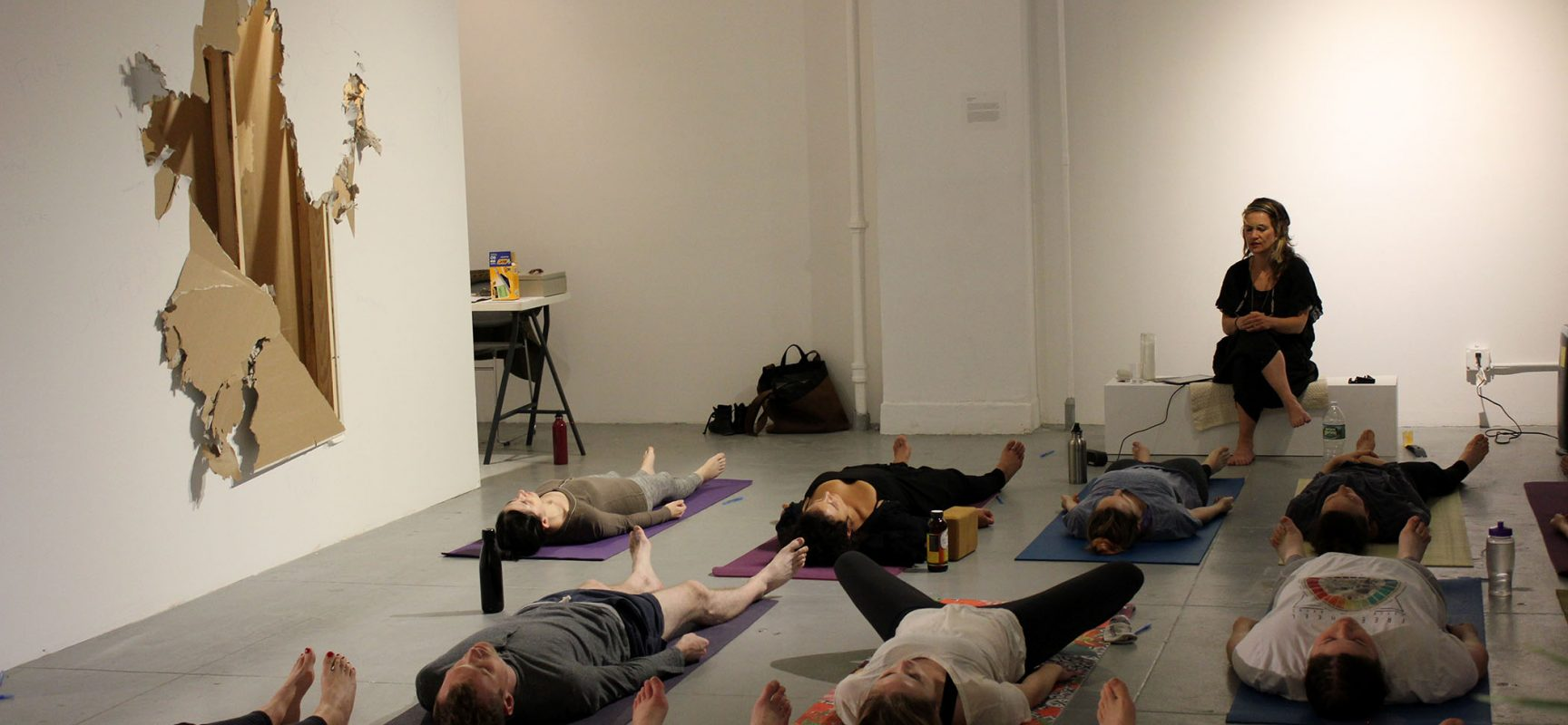 """   Secret Chakra, Feminist Economics Yoga."" Documentation from Feminist Economics Yoga Workshop at EFA Project Space, NYC 2017. Images Courtesy of the Artist."