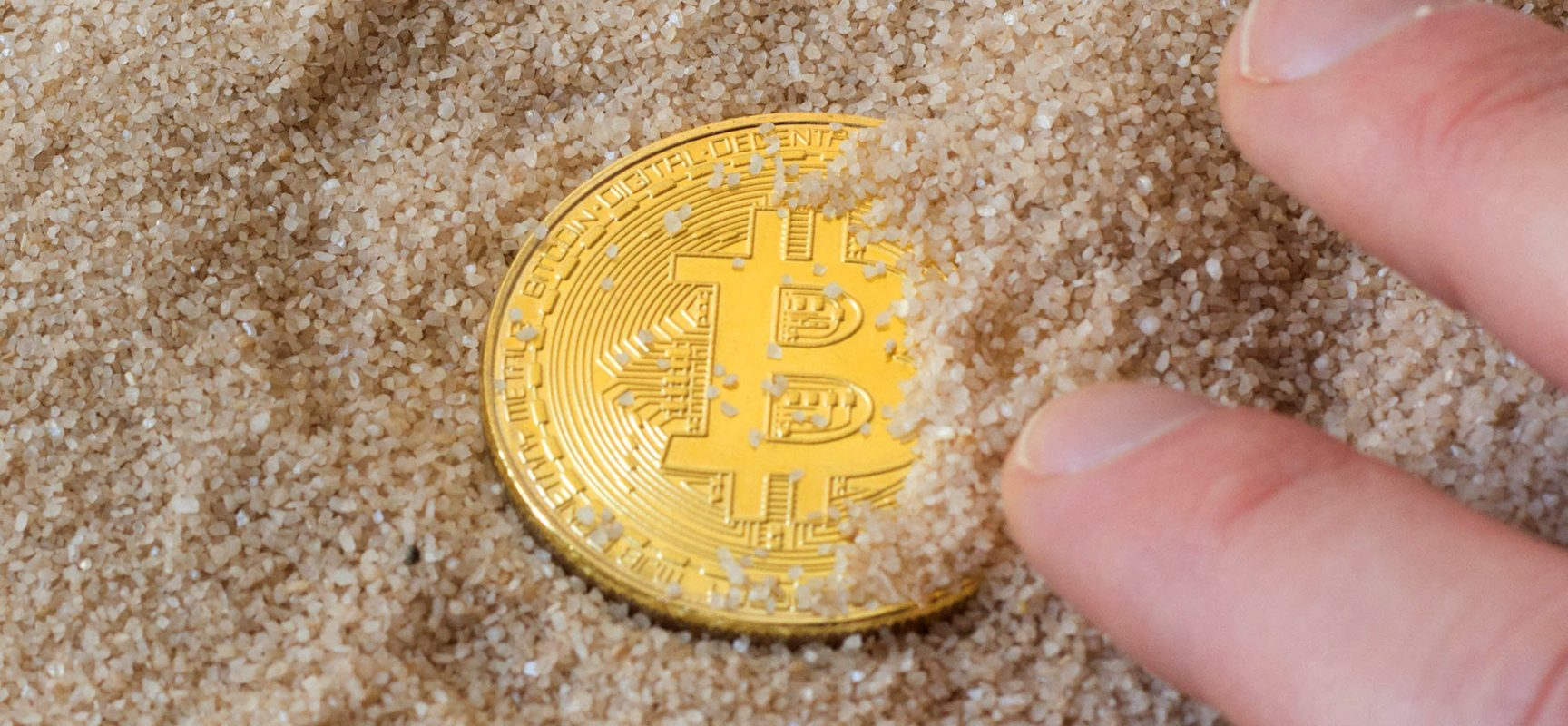 Photo:       Bitcoin in Sand    by    Marco Verch   ,    CC-BY 2.0    via    Flickr   .