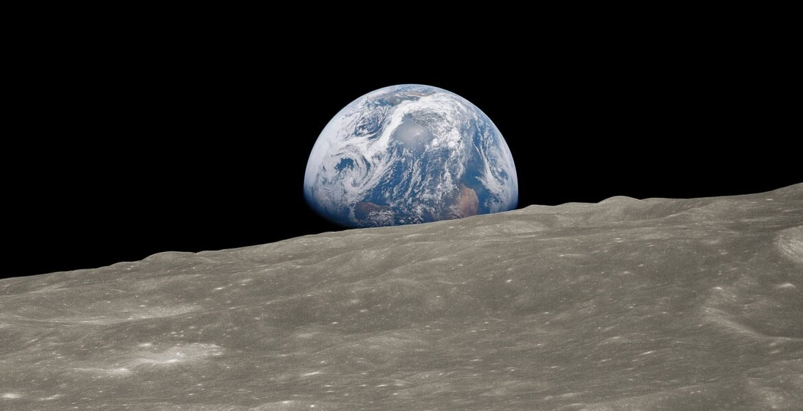 A view of the Earth, seen rising from the surface of the moon. Courtesy NASA.