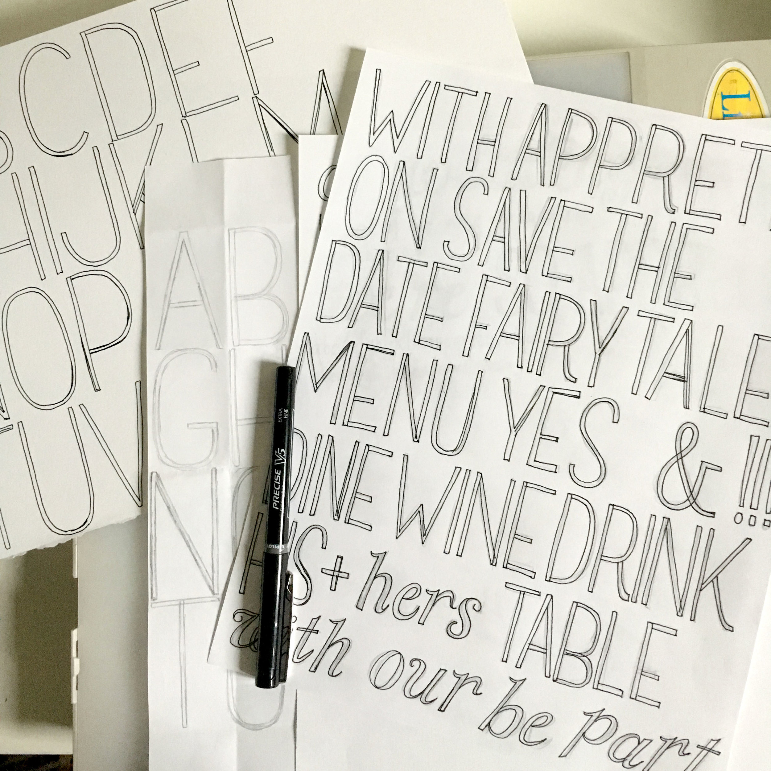 More sketches and inked letters inspired by the original print. These were then used to create a font to put into the invitation suites so they could be easily customized.