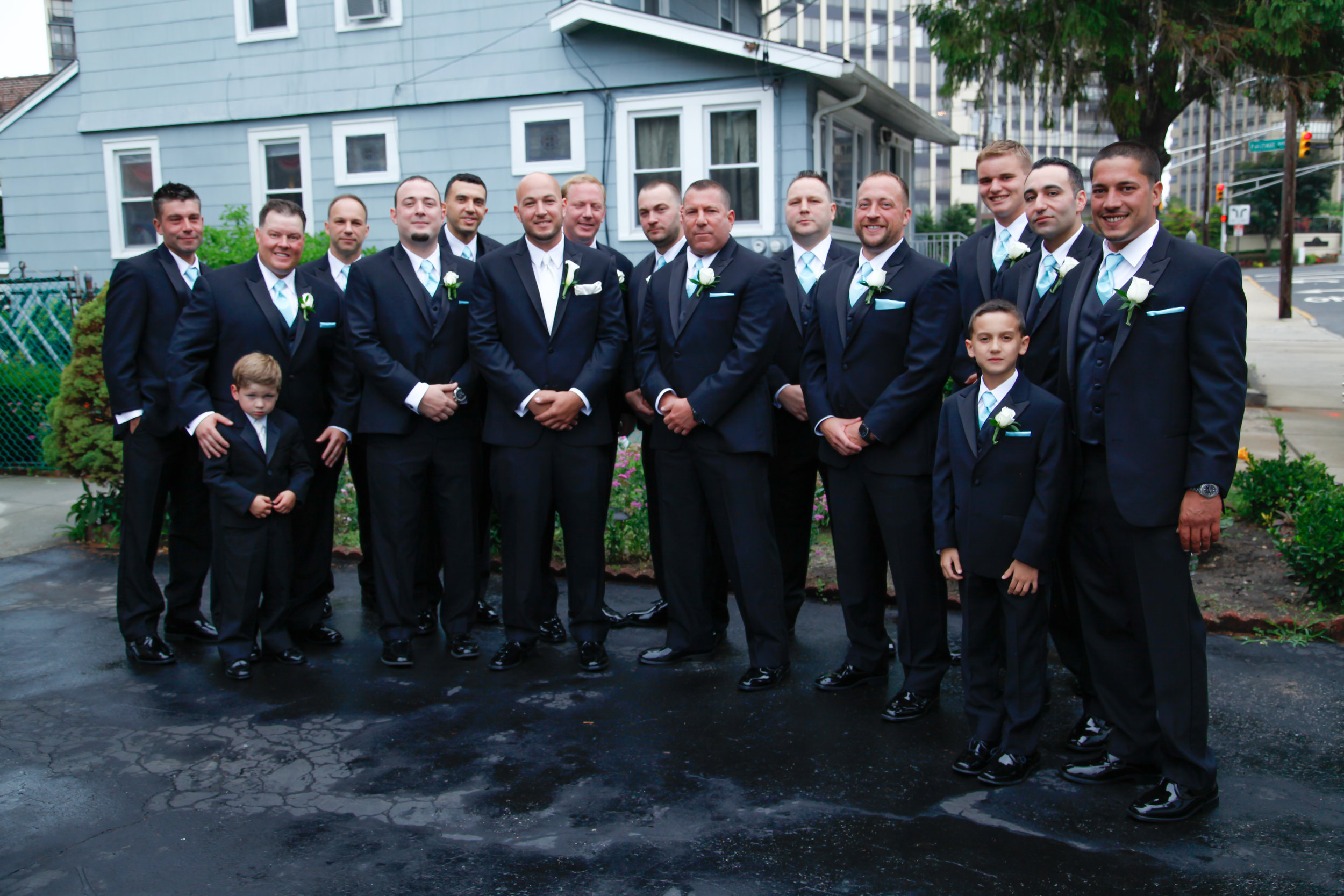 Wedding party wearing Black slim fit tuxedos