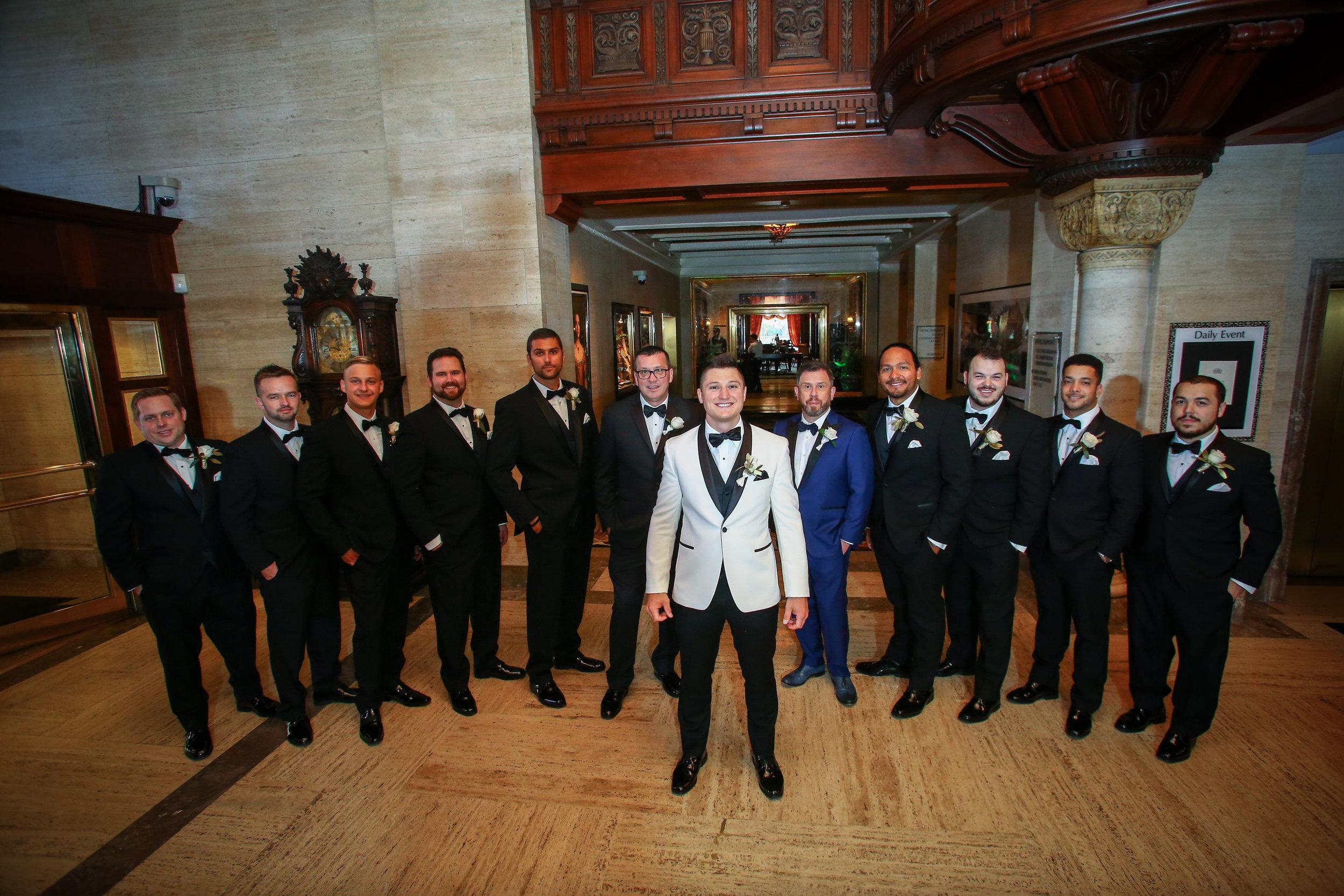 groom and groomsmen wearing slim fit tuxedos