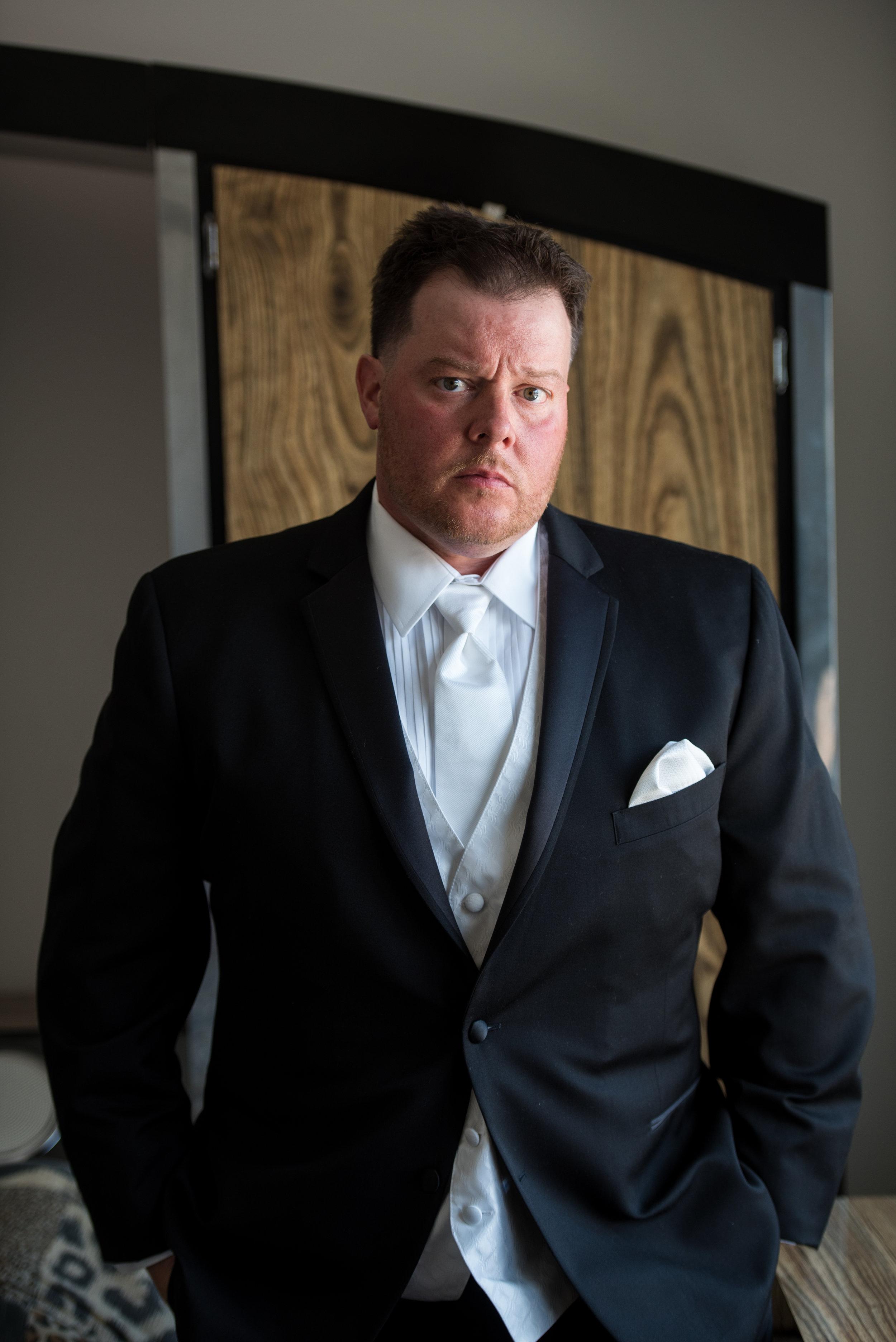 Groom Ike Behar slim fit black tuxedo