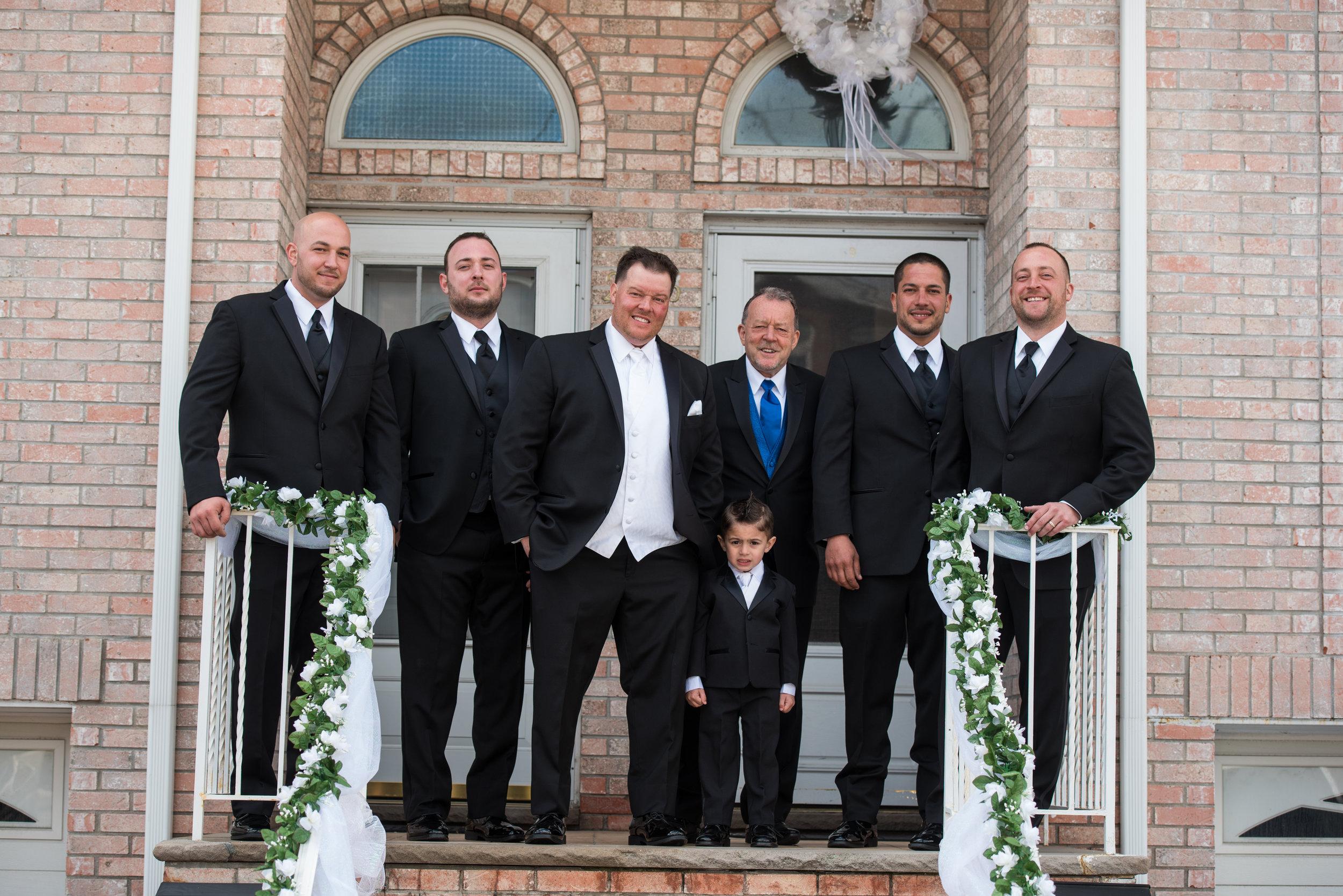 Groom and groomsmen Ike Behar black slim fit tuxedo