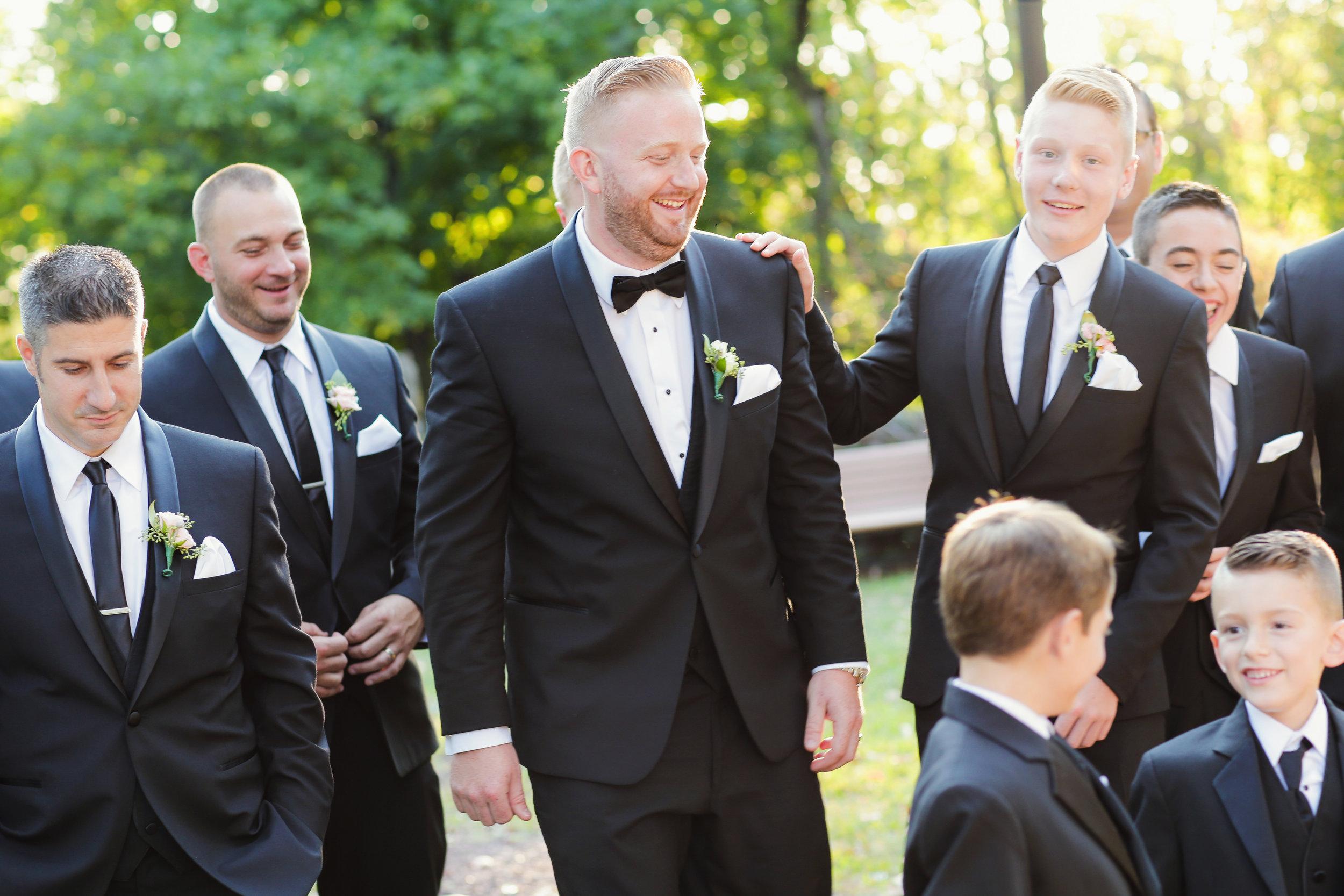 Groom wearing black slim fit shawl tuxedo