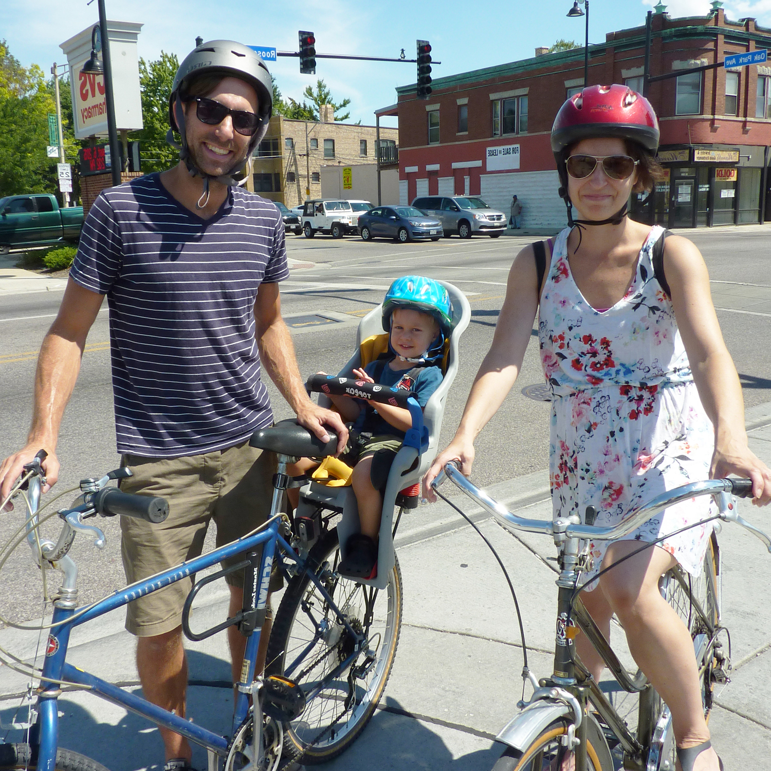 Father, mother and baby on bicycles.