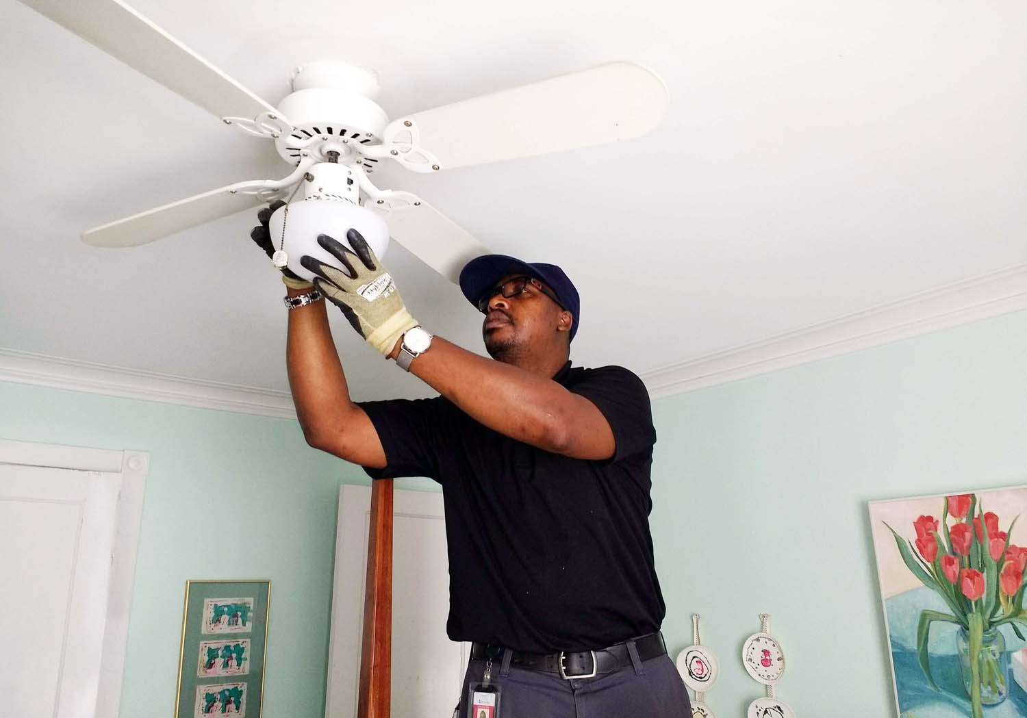 Sam Martin, an engineer with the Energy Efficiency Program, visits homes to replace all light bulbs with long-lasting, warm LED bulbs, at no charge. Call 888-652-2955.