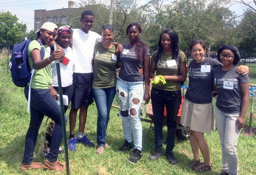 """I Can Fly"" summer youth cohort with mentors in the Harambee Garden."