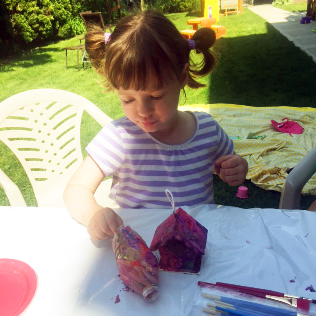 Little girls painting decorations.
