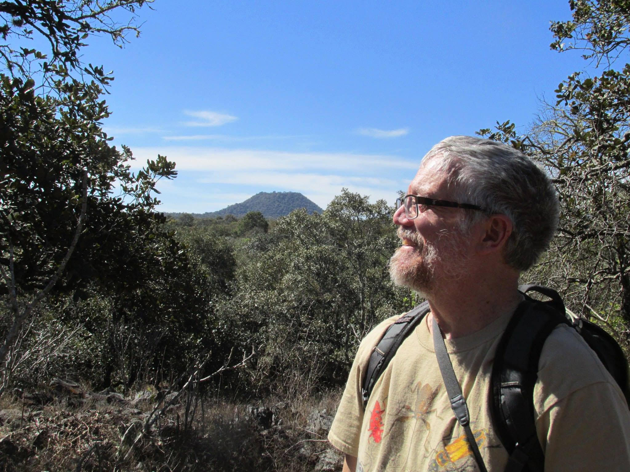 Doug Taron , chief curator at Chicago Academy of Sciences' Peggy Notebaert Nature Museum, pauses during a hike in the mountains of the Transvolcanic Belt of Mexico. Monarchs migrate to this area during the winter.