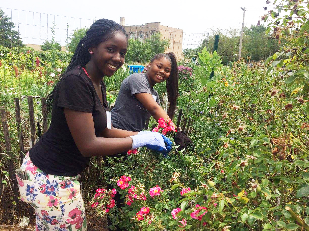 Two students gardening during our inaugural summer youth program in 2017.