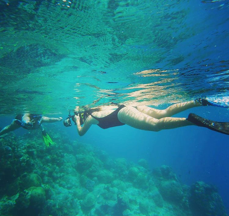 Gabriela working as an underwater photographer at The Great Barrier Reef (Cairns, Australia) / Photograph courtesy of Gabriela Echeverry