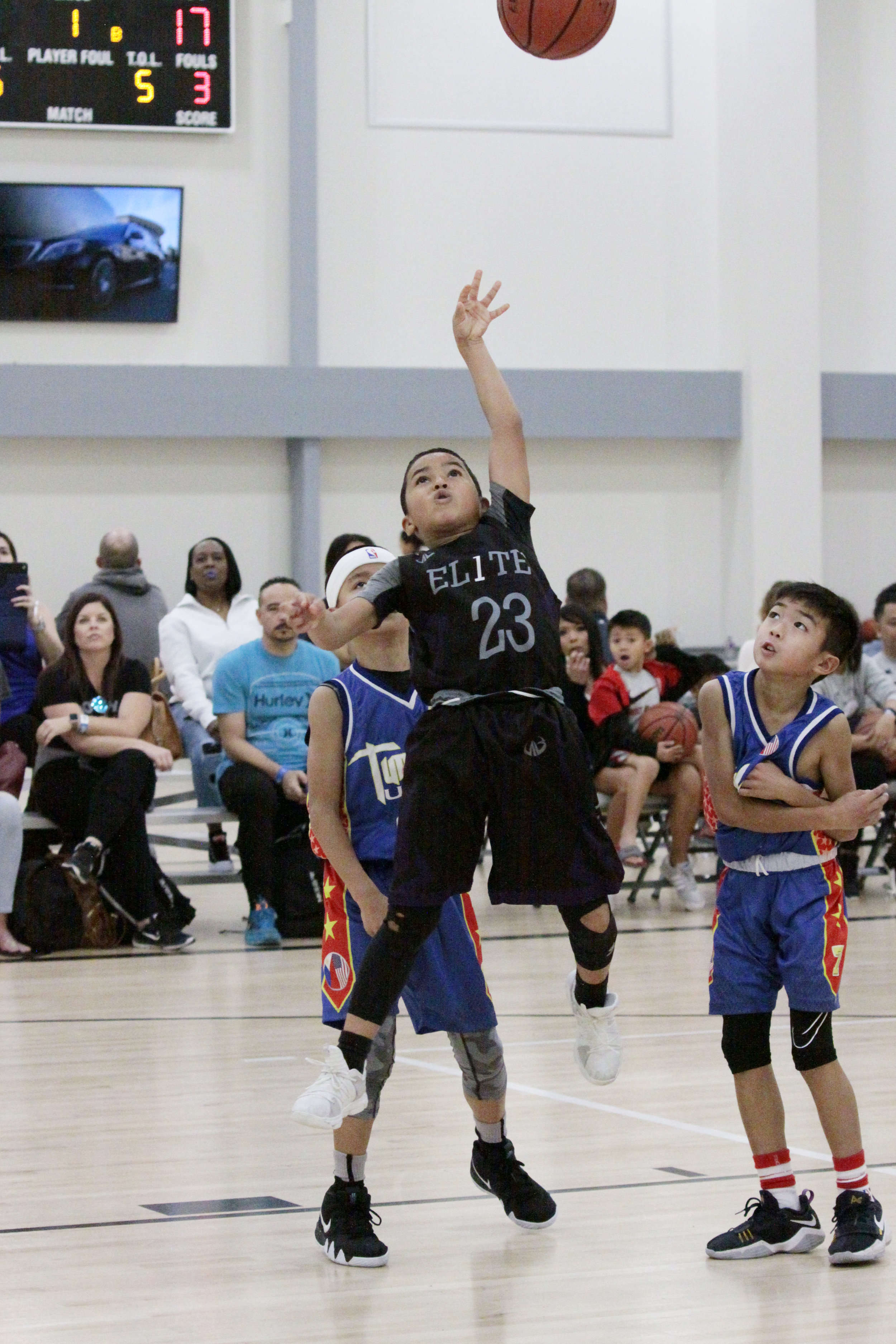 kid shooting a basket