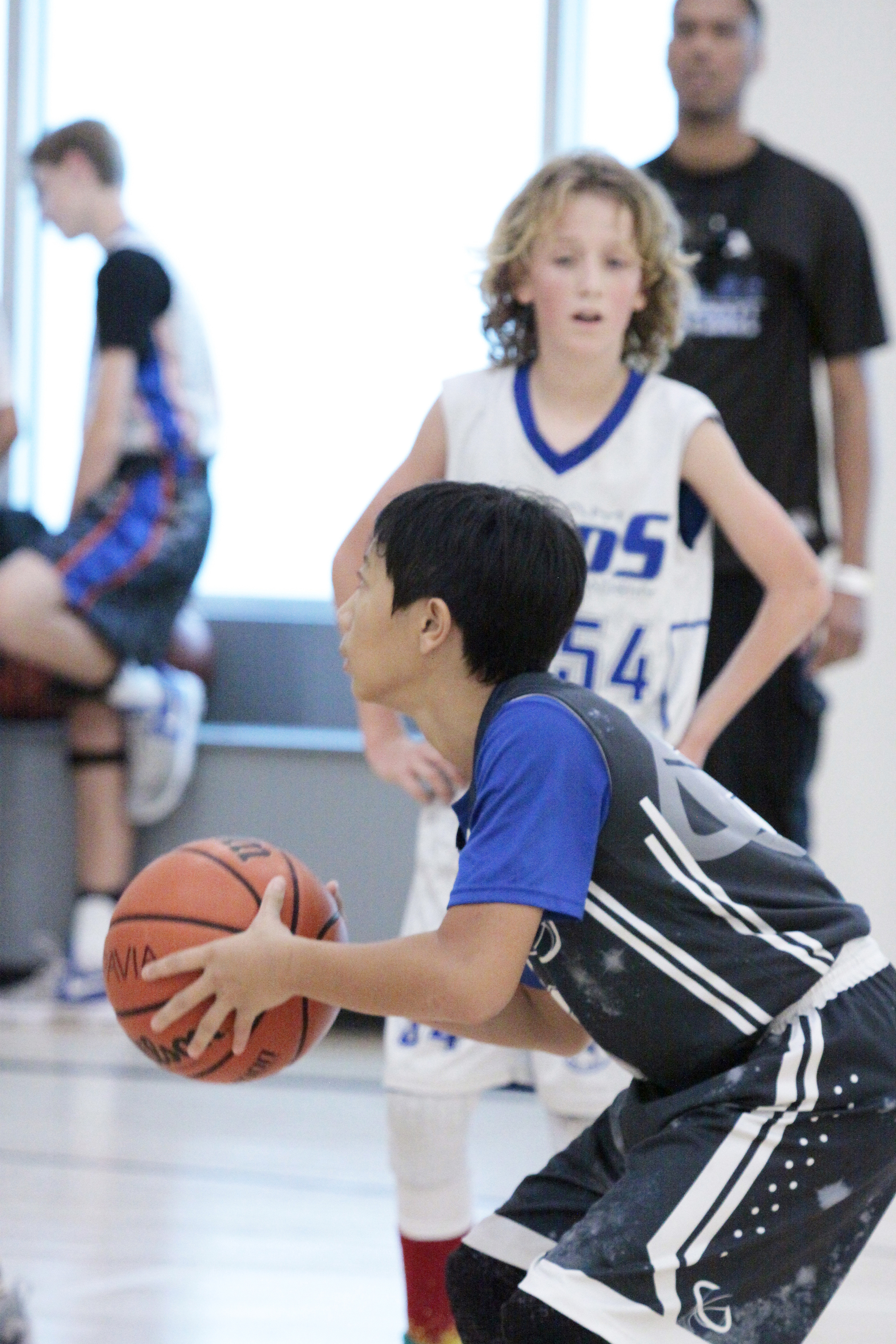 kid playing basketball