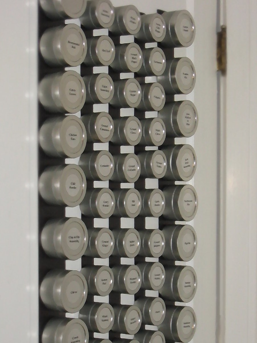 Kim used adhesive-backed Flexible Magnetic Strip applied to the door to hold her Solid Lid non-magnetic Spice Tins