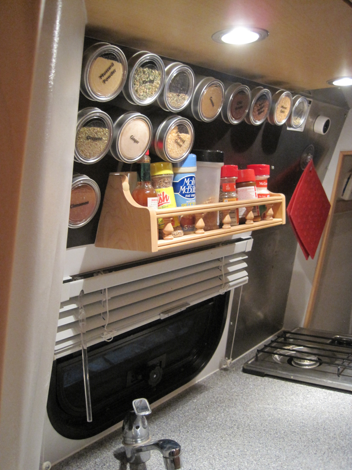 Rose W., Lindsborg, Kansas - Rose installed Flexible Magnetic Material above her RV stove. Using Non-Magnetic Applause Spice Tins, she has created new storage in her motorhome.