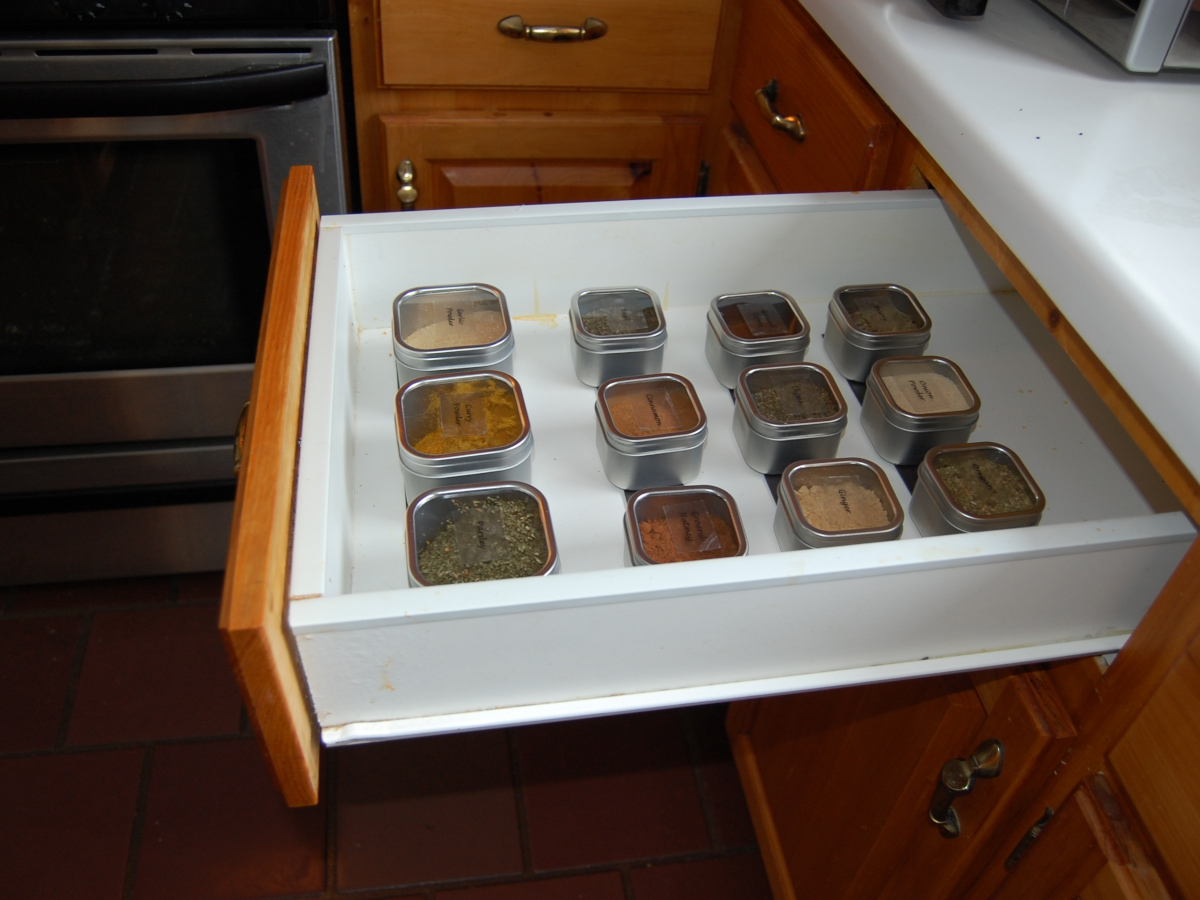 Submitted by Sue T. of Humber Village, Newfoundland and Labrador, Canada  Sue adhered Flexible Magnetic Strips to the bottom of her spice drawer to keep the Square Spice Tins in their place.