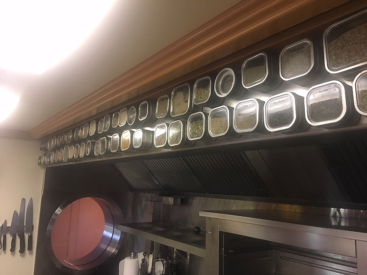 "In this vessel, Chef Dan used 3"" wide Flexible Magnetic Strip with Acrylic Adhesive. Bravada 8 and 16 oz. Spice Tins dominate the space with some 4 oz. Début in the mix."