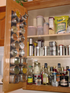 in my own kitchen, organizing my own spice cabinet mess!