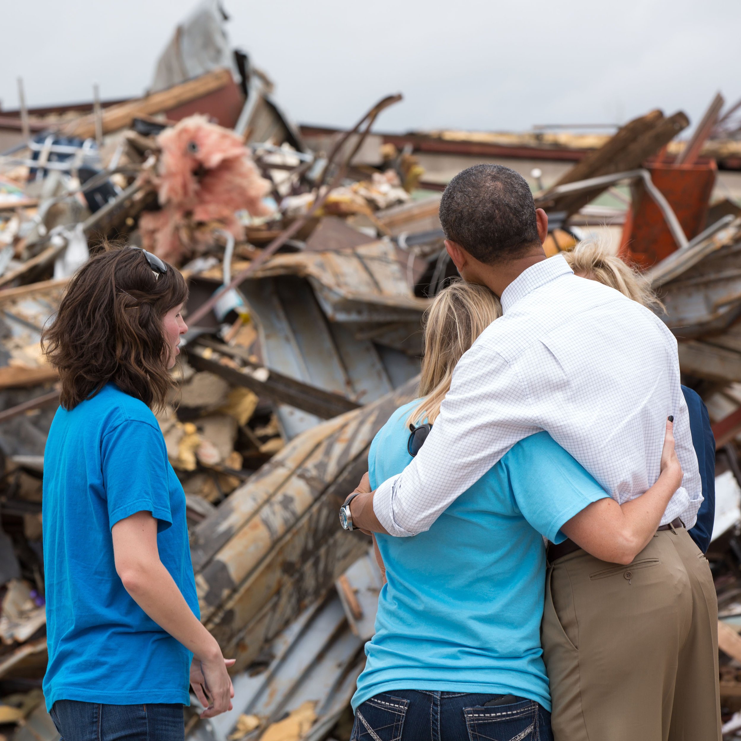 President Barack Obama hugs Amy Simpson, principal of Plaza Towers Elementary School in Moore, Oklahoma, after seven students at the school died in a tornado in May 2013. White House photograph by Pete Souza.