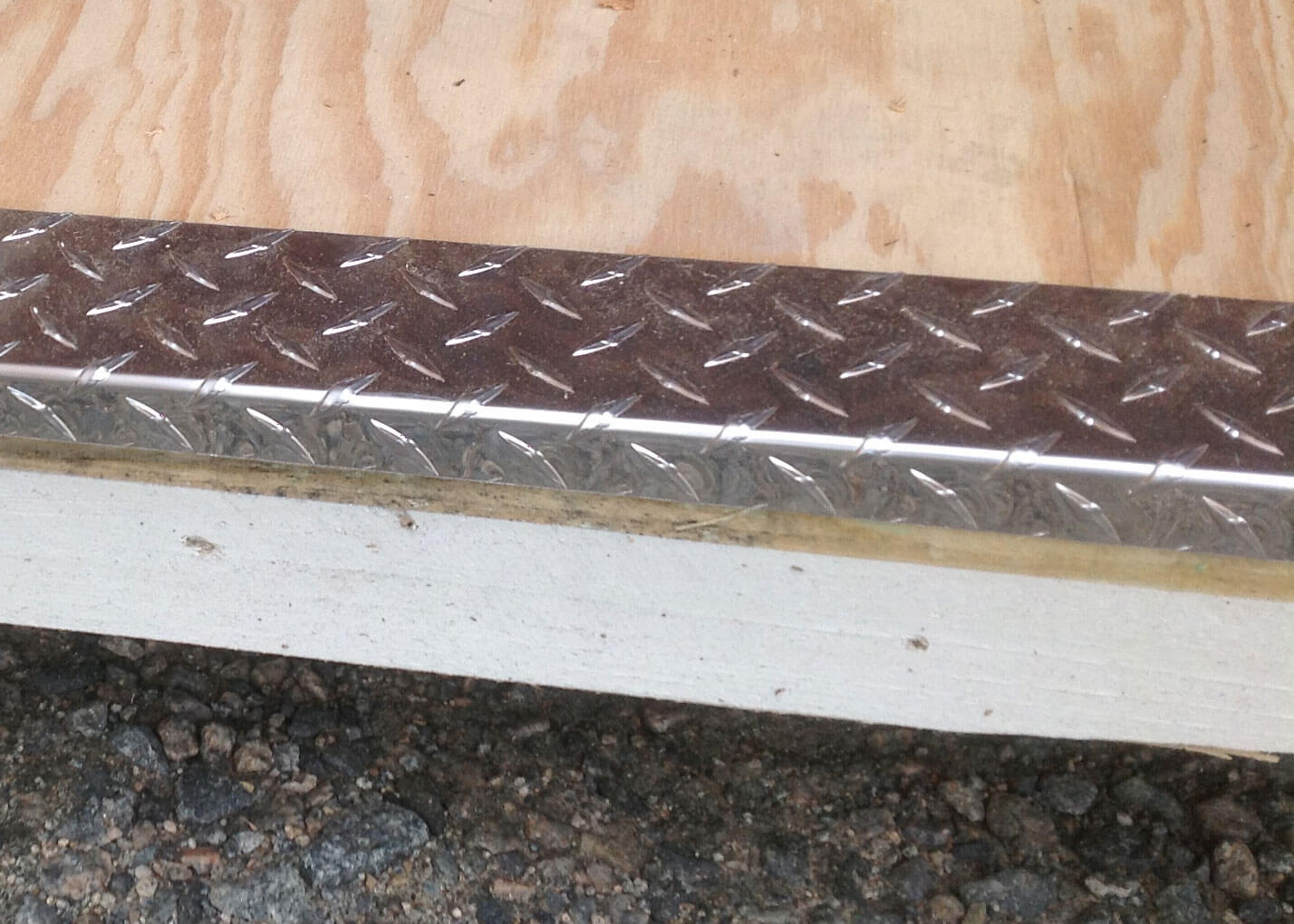 Diamond Plate Threshold $6 per linear foot (not available for garage door openings)