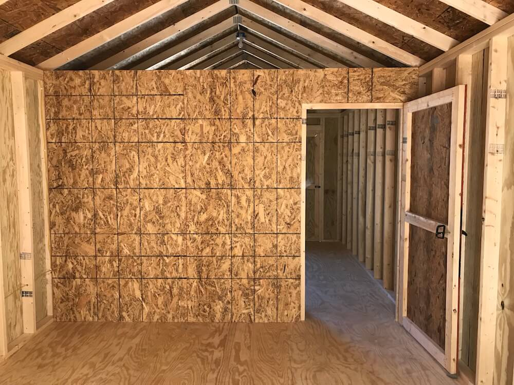 Interior walls can be added to help divide your interior space. The price is: 8' Wide = $200; 10' Wide = $250 12' Wide = $300; 14' Wide = $350  Extend OSB wall to ceiling for $100. Add 3-foot interior door for $100.