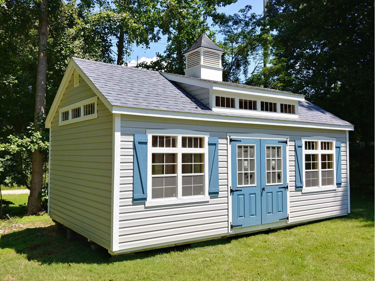Premier sheds are the tallest sheds we offer at nearly 14 feet high. Deluxe standard features like the classic trim around windows and doors, four windows with transom glass above and striking z-shutters elevate these sheds to the next level. Available in the utility design with vinyl or lap siding.
