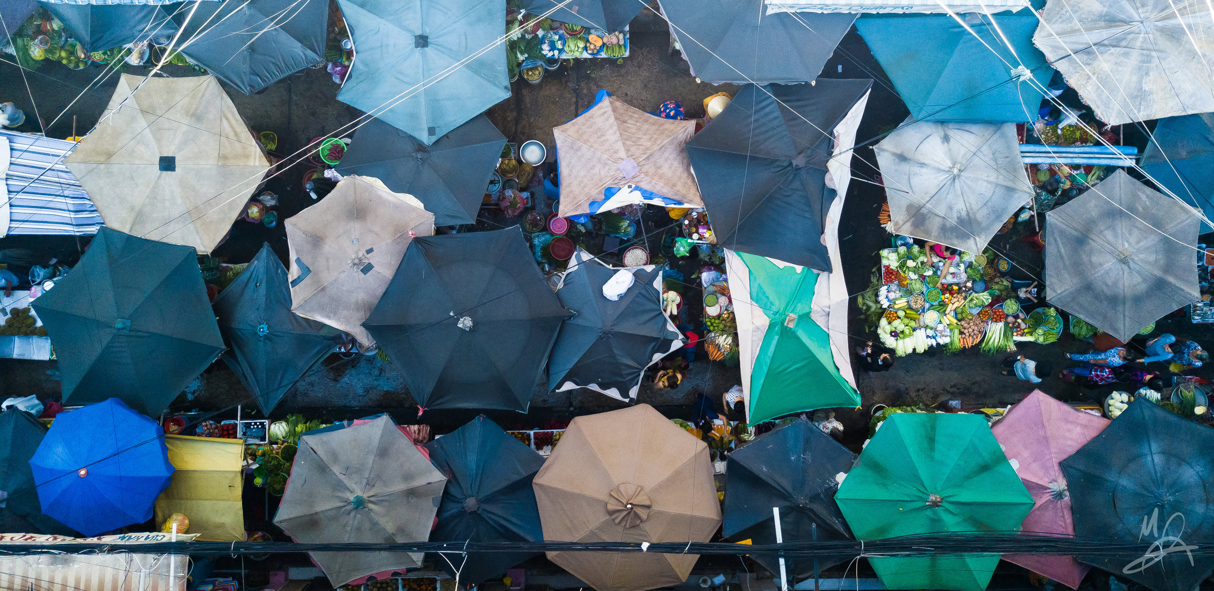 Umbrellas in a market 1/3