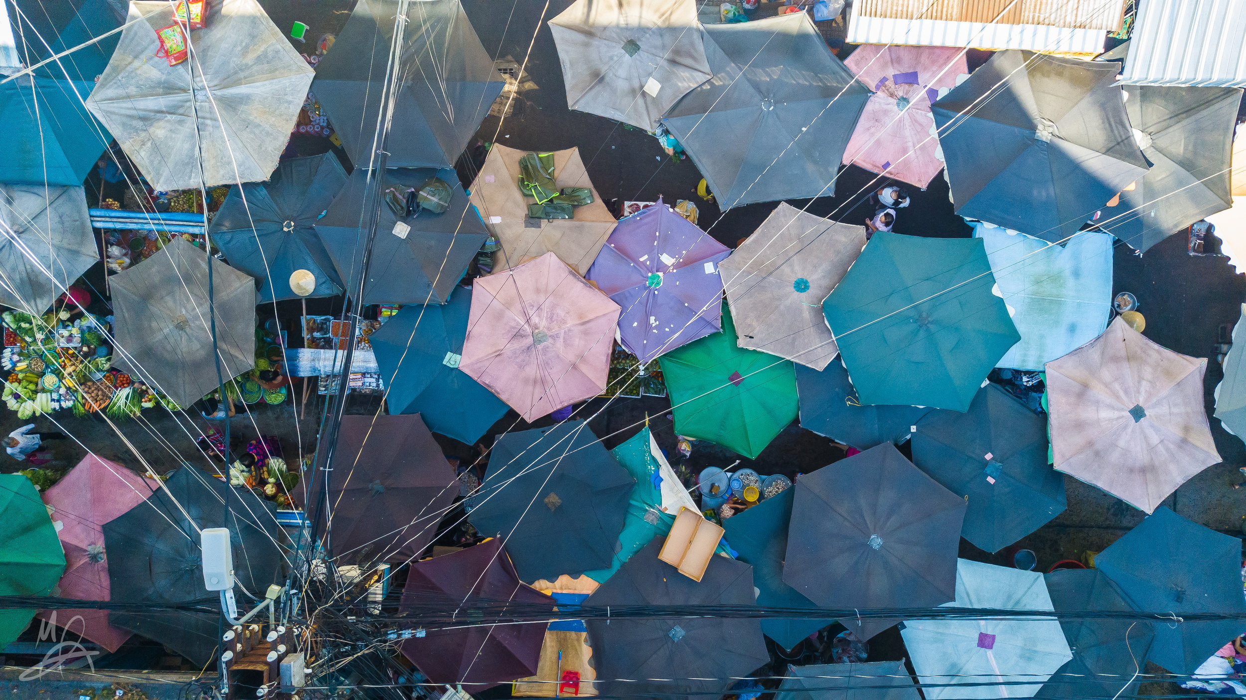 Umbrellas in a market 2/3