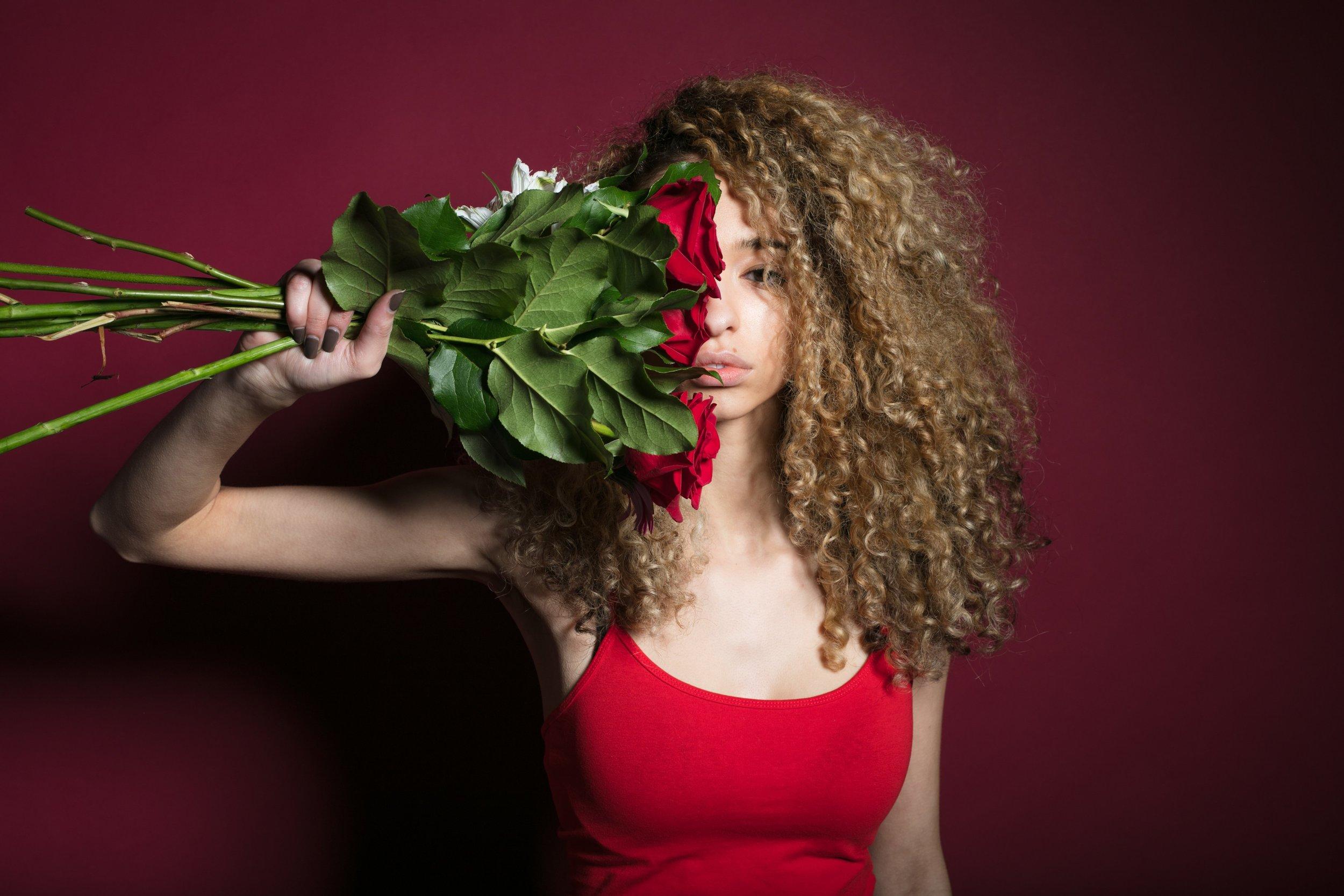 woman-grasping-flowers_4460x4460.jpg