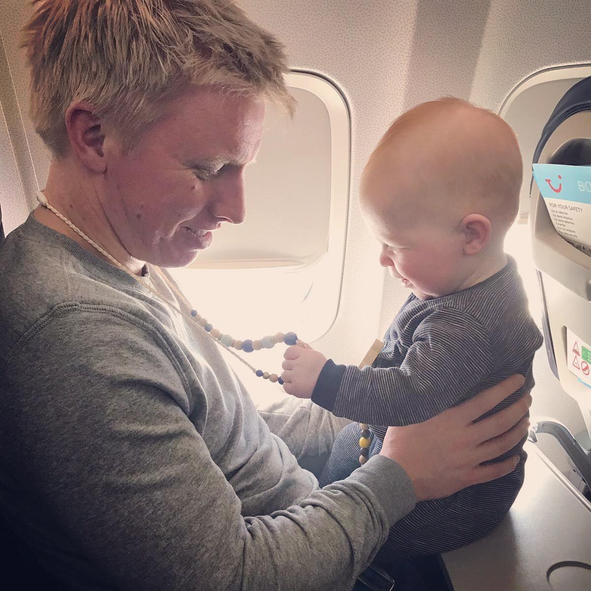 - Mícheál O'Leary keeping baby Séan busy on the plane…