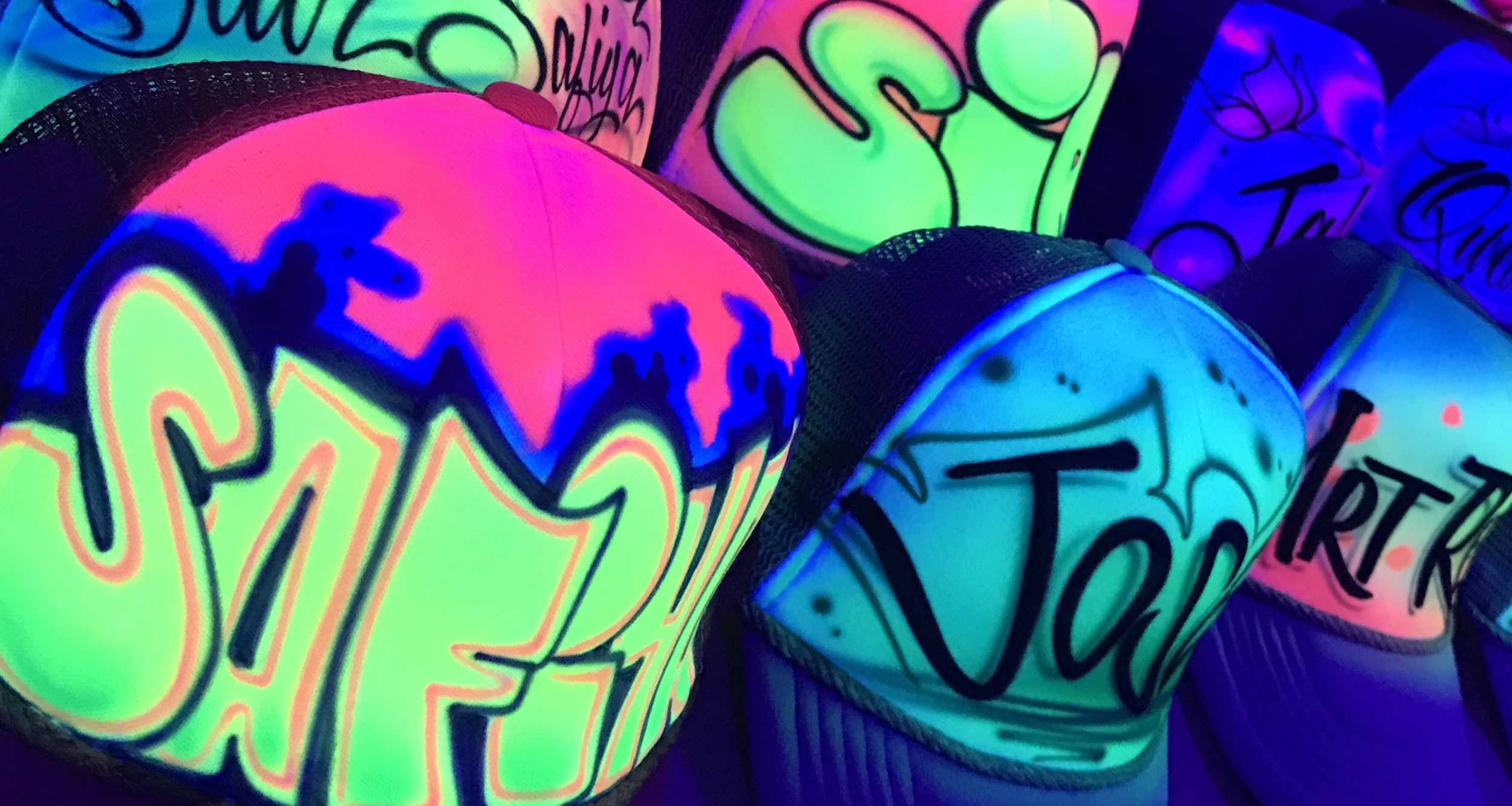 Airbrushed Trucker hats Blacklight glow paint closeup