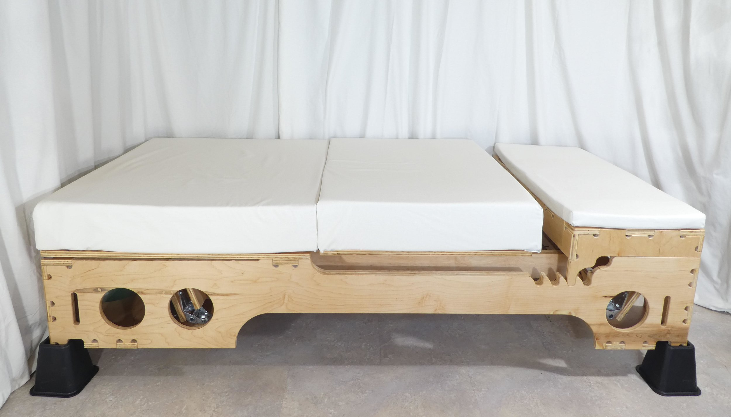 In this photo, the bottom sheet has been removed. Custom, washable mattress covers protect each of the mattress sections.