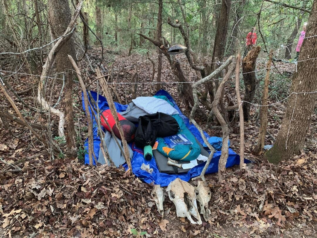 An example of a wilderness survival shelter.  Not terribly effective for keeping out rain (thankfully it didn't rain), but extremely effective in warding off evil spirits…