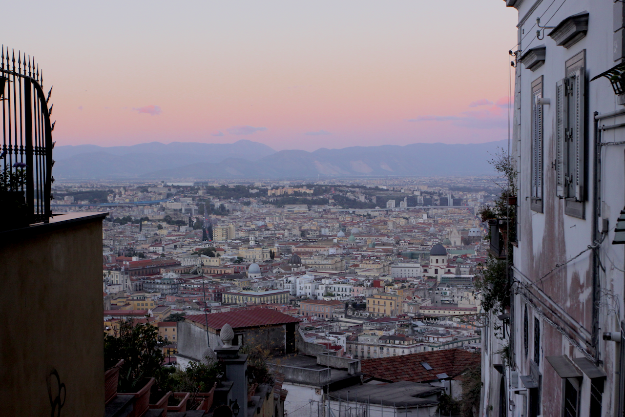Sunset view of Naples city and hills