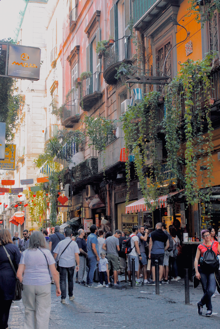 Colourful stores along Via dei Tribunali