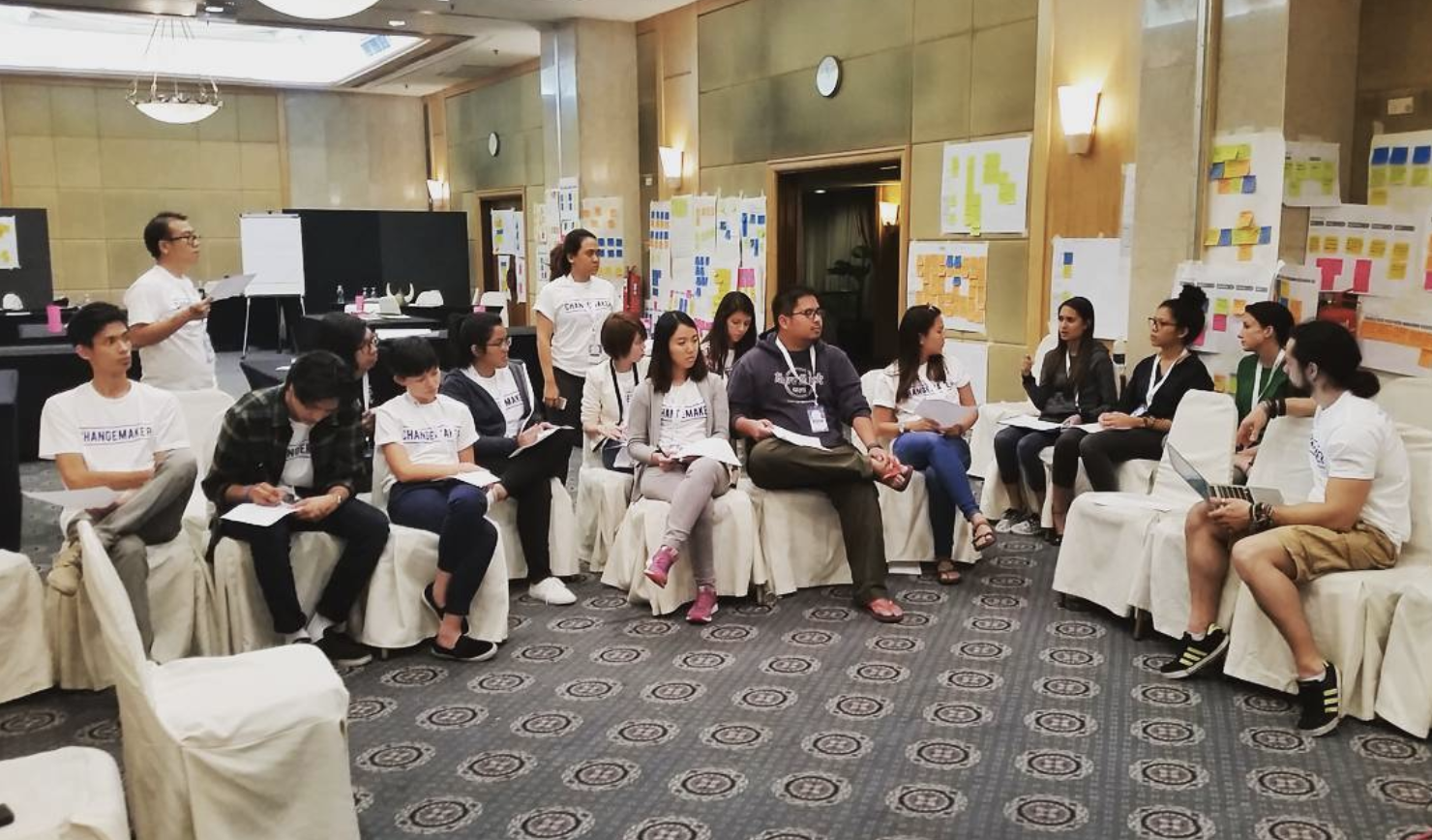 During a mentoring workshop for selected Innovation Challenge participants, a group discusses how they can use human-centered design principles to sharpen their ideas.