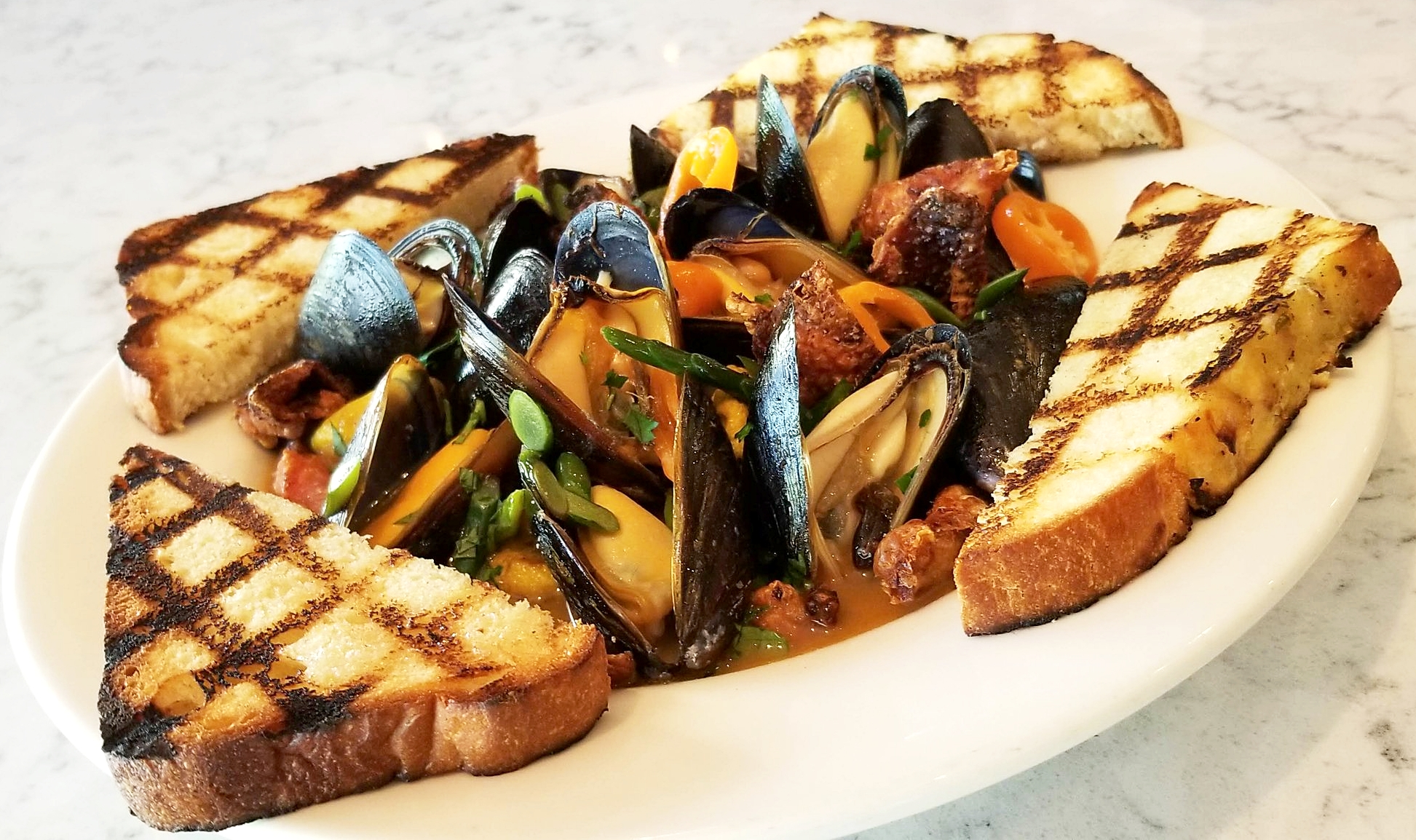 Mussels . Garlic Scapes . Heirloom Tomato Broth . Cured Crispy Chicken Skin . House  Focaccia